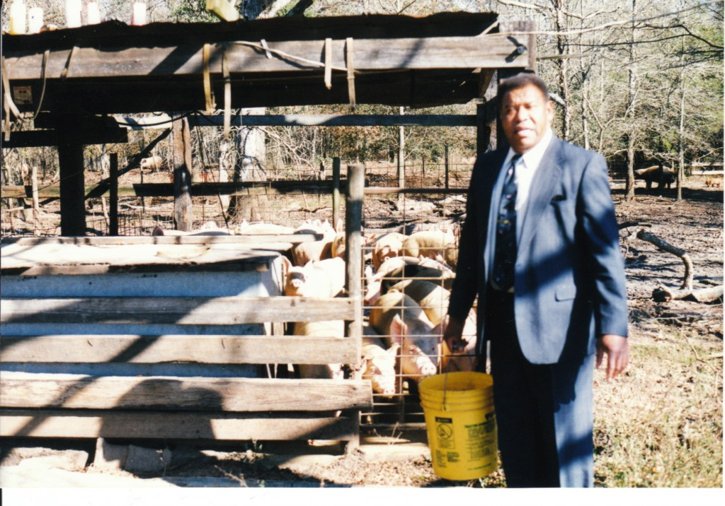 Daddy preparing to feed hogs wearing his Sunday best. Taken several years ago.